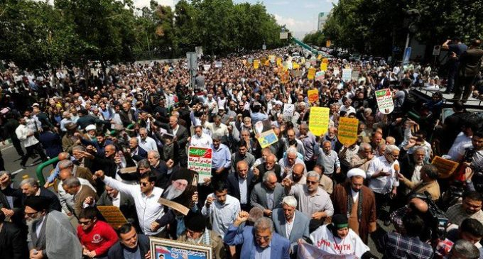 Videos: Iran protesters confront police at parliament