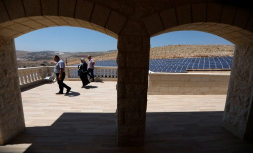 Palestinians use the solar panels to reduce their power shortage